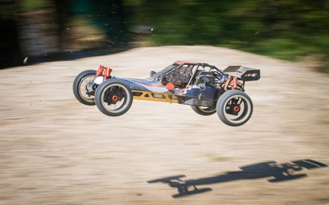 a customer's RC car with 3D Printed Car Parts doing jumps on a dirt course